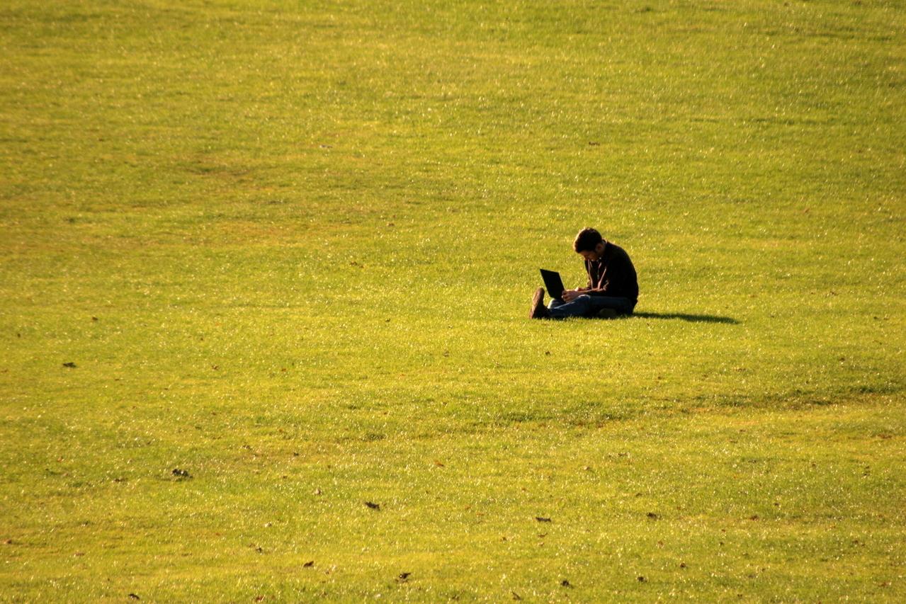sitting-on-grass-1309209-1279x852